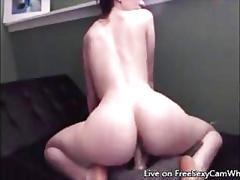 Beautiful busty girl riding a dildo