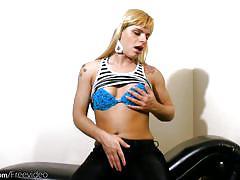 Feminine t-girl teases her milky tits and jerks off shecock