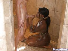 Black soapy chick sucking a vanilla cock
