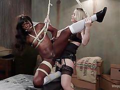 Tied ebony gets fucked by a blonde milf