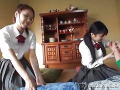 Two asian schoolgirls sharing a hard cock