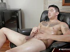 Muscled guy jerks his dick in a living room