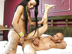Tattooed dude takes tranny's jizz all over his face