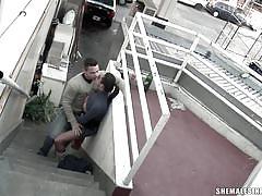 Guy sucking brunette shemale's cock in public
