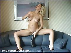 Blonde takes on huge dildo