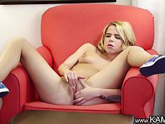 Blonde babe rubs her warm pussy