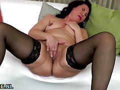 Mature amateur rubs her moist pussy