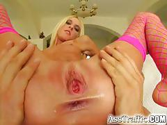 Ass traffic thin blonde with pink fishnets spreads her tight pussy