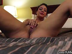 Brunette plays with her hot pussy