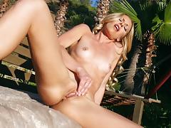 Watch lena nicole pleasing her pussy in the sunshine