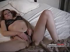 Brunette plays with her hairy pussy