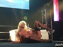Horny milf on masturbating on public stage