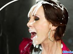 Clothed babe drenched with cum