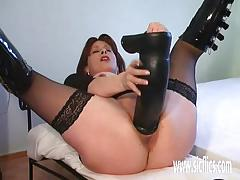 Amateur takes on her huge dildo