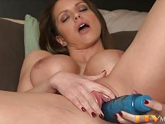 Busty milf toys her warm pussy