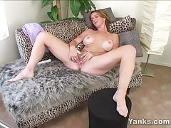 Sensual babe plays with her wet pussy