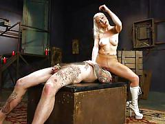 Eccentric blonde mistress punishing her submissive man
