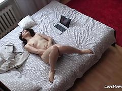 Brunette rubs her hot pussy