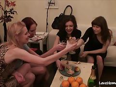 Hot lesbian foursome in the living room