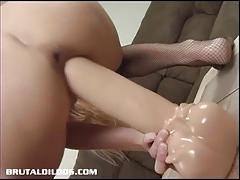 Blonde takes on her huge dildo