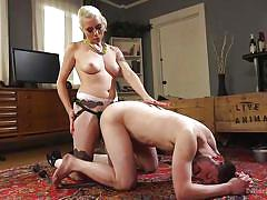 Sexy blonde domina playing with her minion