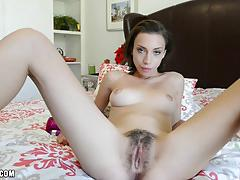 Amber toys her young hairy pussy