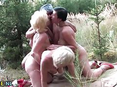 Mature ladies sharing cock outdoor