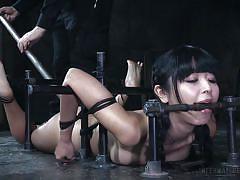 Asian beauty in steel restraints