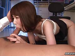 Asian brunette stuffs her mouth with cock