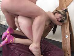 Girl gets double penetration in bondage