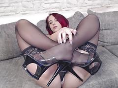 Stocking clad nina devil masturbating