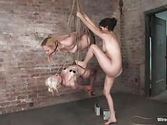 Brunette domina vibrating two tied blonde twats