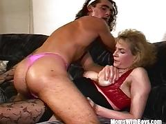 Blonde milf fucks a man in pink thong