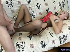 Lingerie clad blonde sucking cock
