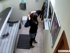 Teen girl touching her pussy in public solarium