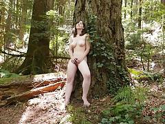 Randy babe masturbating outdoors