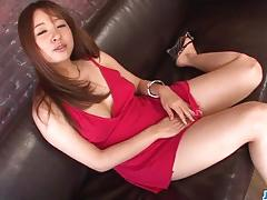 Asian brunette plays with her moist pussy