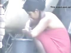 Indian hot village girl bathing outside,