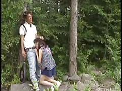 Japanese blowing in the woods.