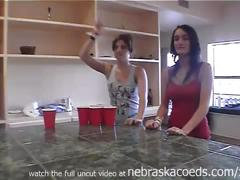 Friends losing at strip beer pong
