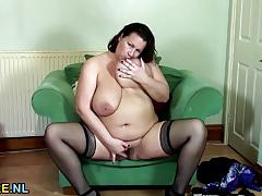 Chubby brunette plays with her warm pussy