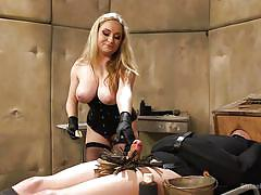 Curvaceous blonde domina playing with her minion