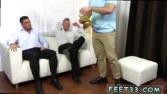 Handsome man gets his feet worshiped by a bearded hunk