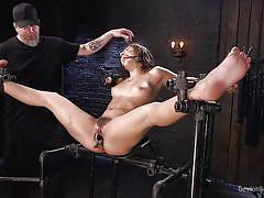 Huge pole in her twat, clamp on her clit and a gag in her mouth