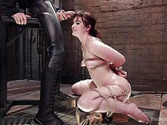 Naughty brunette receiving a sex slave training