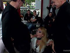 Curvy blonde babe gets her ass whipped in public