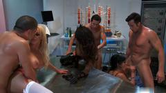 Masked brunette has group fuck session in a chemistry lab