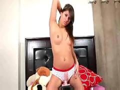 Teenage girl gets on her machine and rides.f70