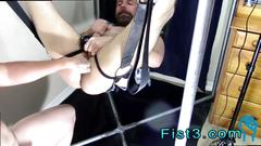Ugly twink gets fist fucked hard on a sex swing