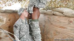 Cute soldier boy swallows a big black cock outdoors
